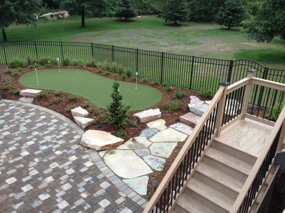 ... Recessed Free Form Pool, Outdoor Kitchen, Firepit and Putting Green
